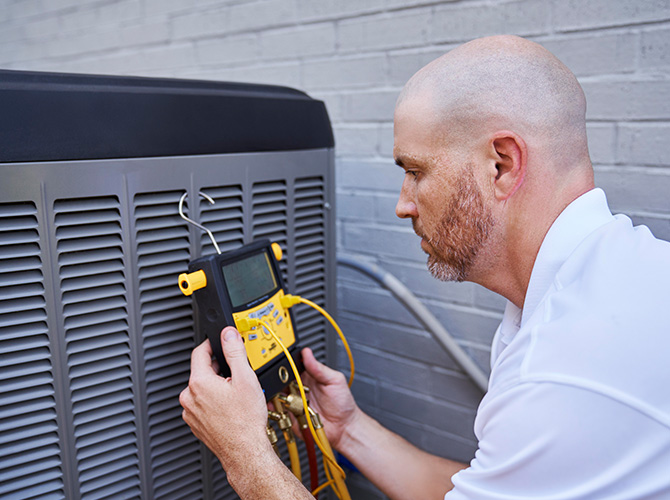 Man working on an AC Unit