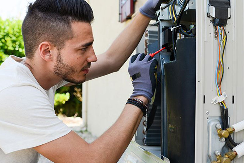 man working with HVAC equipment